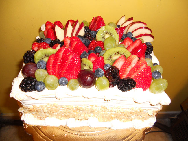 European Style White Sponge Cake Moistened With Rum Syrup To Give It That Soft Juicy Flavor Topped With Fresh Hand Cut Fruits